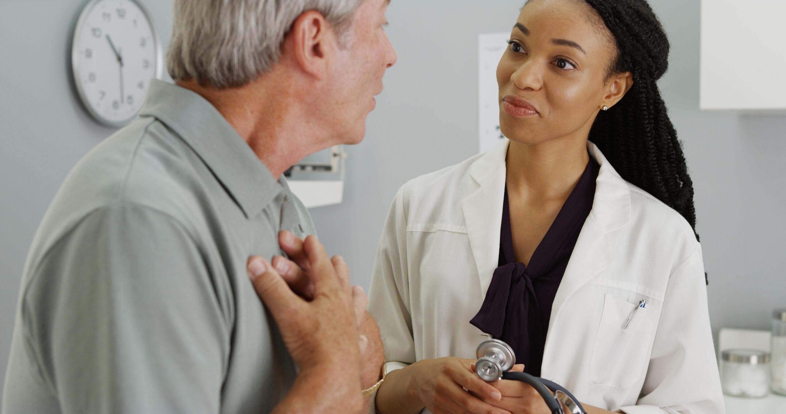 Black female doctor using excellent communications skills talking with older male patient | Vanguard Communications | Denver, Knoxville, TN, Jacksonville, FL