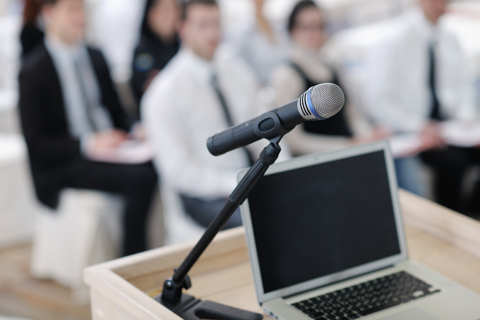 Healthcare Management & Marketing Talks & Conferences | Vanguard Communications | microphone near podium and laptop