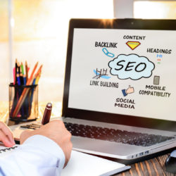Google Juice SEO | Vanguard Communications | MedPage Today | person taking notes looking at a website page with a graphic explaining SEO