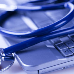 Marketing for physicians, stethoscope and laptop
