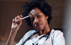 Black female doctor thinking   Vanguard Communications   Denver, CO   San Jose, CA