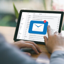 Hands tapping tablet to open email marketing inbox | Vanguard Communications | Denver, CO | San Jose, CA