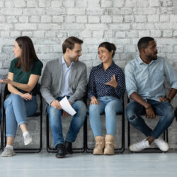 Professionals at a digital marketing agency talking | Vanguard Communications | Denver, CO | San Jose, CA