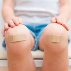 Fixing clinic problems with data analysis | The Business of Medicine | Vanguard Communications | Photo of child with bandaids on knees