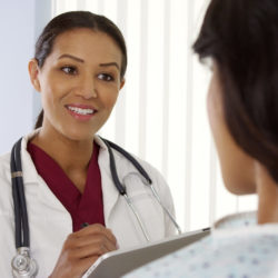Bedside Manner and Patient Interaction | Vanguard Communications | Photo of doctor speaking with patient