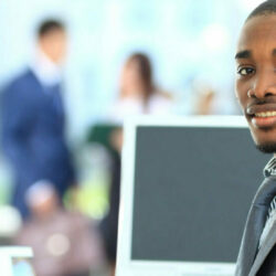Doctor blog | Vanguard Communications | African American man at office