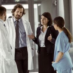 A group of doctors talking about hiring medical marketers | Vanguard Communications | Denver, CO | San Jose, CA