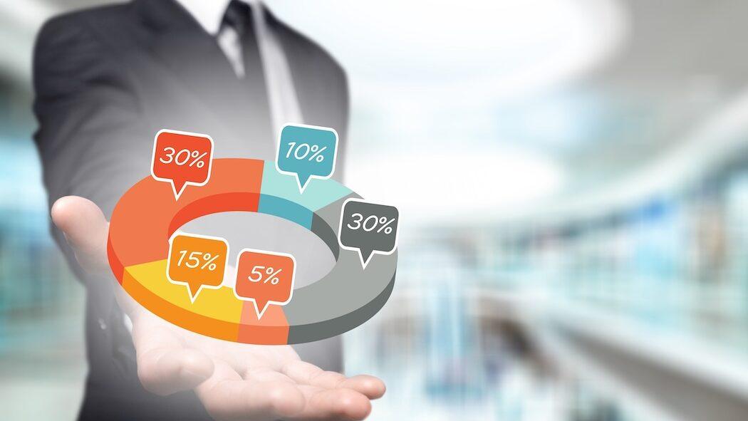 Man reviewing marketing analytics graphic   Vanguard Communications   Denver, CO