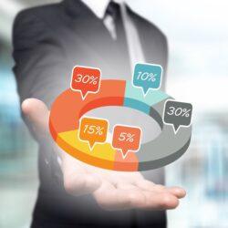 Man reviewing marketing analytics graphic | Vanguard Communications | Denver, CO