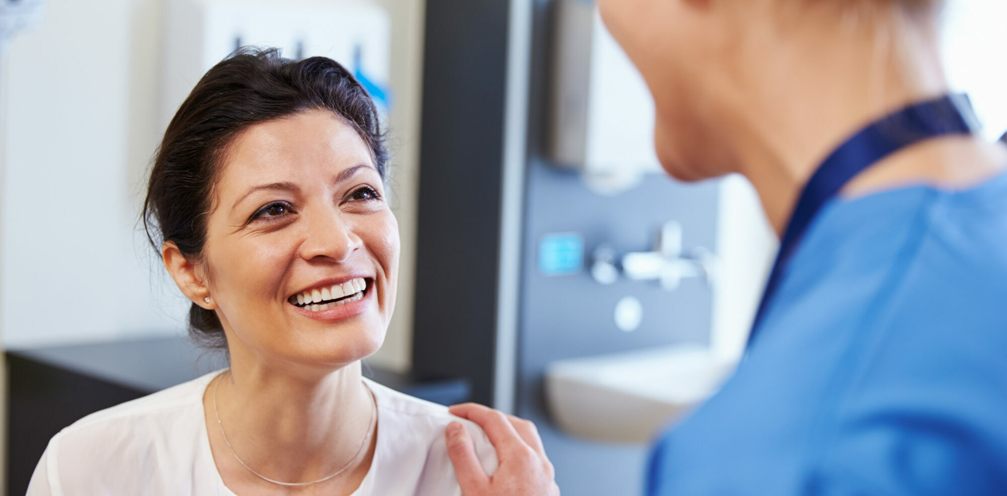 female patient smiling at her doctor after a good patient experience | Vanguard Communications | Denver