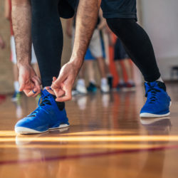 How does a basketball player bending to tie his shoe relate to healthcare phone etiquette? | Vanguard Communications | Denver